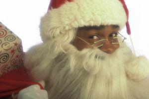 Santa holding bag of gifts