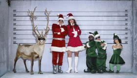 Santa, helper, elves and reindeer in police identity parade, portrait