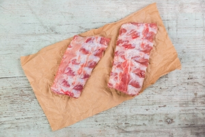 Raw spare ribs on brown paper