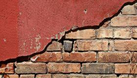 Grunge Brick under Red Plaster