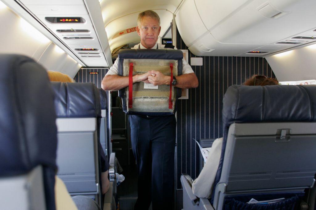 Orlando Airport, Delta commuter jet, flight attendant