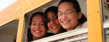 Middle school students on a school bus at the Drug Free Youth In Town, Awards Luncheon at Hyatt Regency Hotel.
