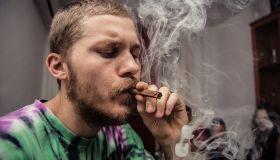 Close-Up Of Young Man Smoking Marijuana Joint