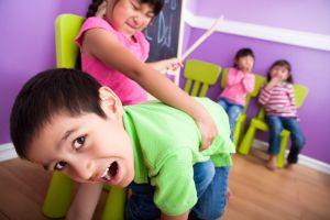 Boy getting spank in class