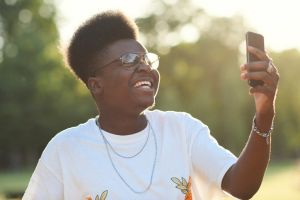 Man having fun taking a selfie with a smart phone