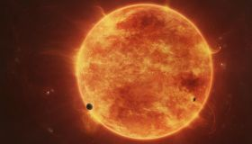 A massive red dwarf consuming planets within it's range.