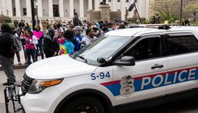 Columbus Police cruisers round the Ohio Statehouse interact...